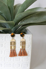 Rust - Tassel Statement Earrings on Plant Product Shot
