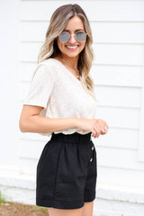 Model wearing Black Paperbag Waist Linen Shorts Side View