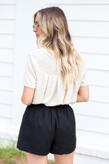 Model wearing Black Paperbag Waist Linen Shorts Back View