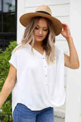 Model wearing White Twisted Hem Button Up Blouse Side View
