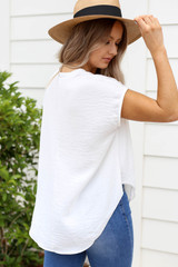 Model wearing White Twisted Hem Button Up Blouse Back View