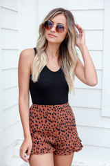 Model wearing Brown Spotted Ruffle Shorts