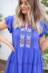 Model wearing Blue Embroidered Mini Dress Detail View