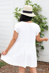 Model wearing White Embroidered Mini Dress Back View