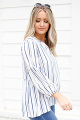 Model wearing Navy and White Striped Balloon Sleeve Blouse Side View