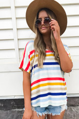 Model wearing Rainbow Striped Hooded Top