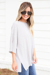 Model wearing Grey and White Striped Oversized Top Side View