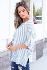 Model wearing Blue and White Striped Oversized Top Side View