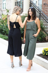 Models wearing Black and Olive Cropped Tie-Back Jumpsuit