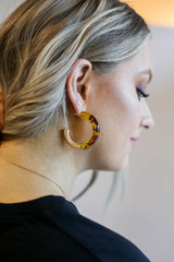 Tortoise - boutique fashion earrings with half gold half acrylic design on Model