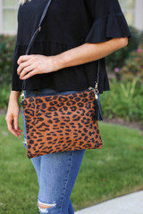 Tan - leopard print oversized clutch with detachable strap on model