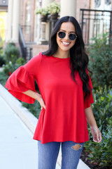 Red - Model wearing the Neely Tiered Sleeve Top in red- front view