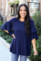 Navy - Model wearing the Neely Tiered Sleeve Top in Navy front view