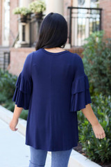 Navy - Model wearing the Neely Tiered Sleeve Top in Navy back view