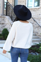 Model wearing Ivory Balloon Sleeve Sweater From Dress Up Back View