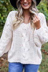 Dress Up Model wearing Ivory Chunky Cable Knit Sweater Detail View