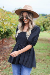 Dress Up Model wearing Black Smocked Bust Puff Sleeve Blouse Side View