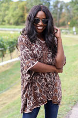 Model wearing Animal Print Oversized Poncho from ShopDressUp- Front View