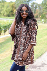 Model wearing Animal Print Oversized Poncho from ShopDressUp- Side View