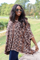 Model wearing Animal Print Oversized Poncho from ShopDressUp- Front Angle View