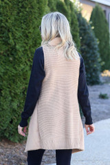 Camel Faux Fur Vest on Dress Up Model  with black long sleeve top and skinny jeans