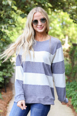 Model wearing Grey and White Striped Pullover Front View