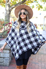 Model wearing White and Black Buffalo Plaid Fold Over Button Up Poncho