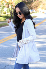 Dress Up Model wearing Taupe Crochet Sleeve Babydoll Cardigan Side View