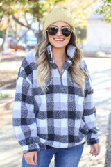 Model wearing theNina Sherpa Buffalo Plaid Quarter Zip Pullover from Dress Up Boutique - Front View