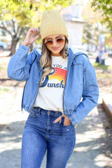 Model wearing the Light Wash Faux Fur Lined Denim Jacket from Dress Up - Front View