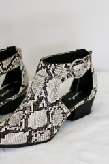 Brown and ivory snakeskin booties with ankle buckle