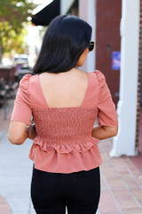 Model of Dress Up wearing the Rust Smocked Ruffle Blouse from Dress Up - Back View
