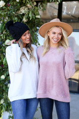 Dress Up models wearing a white and pink faux fur sweater