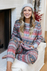 Model wearing the Fair Isle Crew Neck Printed Fleece Pullover from Dress Up Sitting View