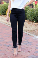 Black - Mid-Rise Jeggings paired  with white blouse.
