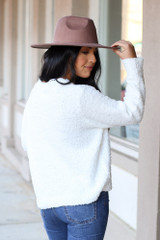 Model wearing the Fuzzy Knit Sweater from Dress Up in Ivory Back View