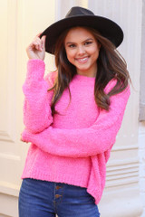 Model wearing the Fuzzy Knit Sweater from Dress Up in Neon Pink with Wide Brim Hat Front View