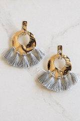 Grey - Hammered Gold and Tassel Statement Earrings Flay Lay on Background