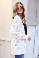 Model wearing the Knit Chenille Cardigan in Ivory from Dress Up with black lace tank