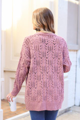 Model wearing the Knit Chenille Cardigan from Dress Up with medium wash jeans