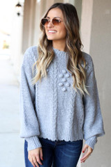 Model of Dress Up Boutique wearing the Cable Knit Pom Pom Sweater  Front View