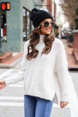 Model wearing the Popcorn Eyelash Knit Oversized Sweater from Dress Up