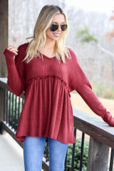 Model wearing the Waffle Knit Babydoll Hoodie from Dress Up with light wash jeans Front View