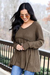 Model wearing the Waffle Knit Babydoll Hoodie in Olive from Dress Up Front View