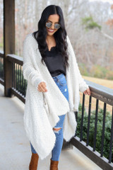 Model wearing the Popcorn Eyelash Knit Cardigan with distressed jeans and black tank Front View