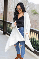 Model wearing the Popcorn Eyelash Knit Cardigan with distressed jeans Front View