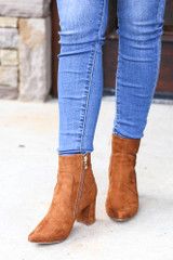 Model wearing the Pointed Toe Block Heel Booties in Camel from Dress Up