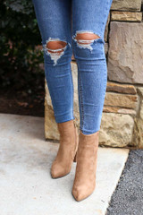 Model wearing the Pointed Toe Block Heel Booties in Tan from Dress Up