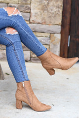 Model wearing the Pointed Toe Block Heel Booties in Tan with Distressed Jeans from Dress Up