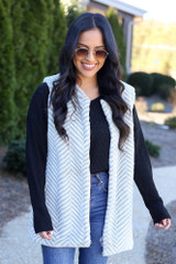 Model wearing the Chevron Faux Fur Vest with black long sleeve top Back View